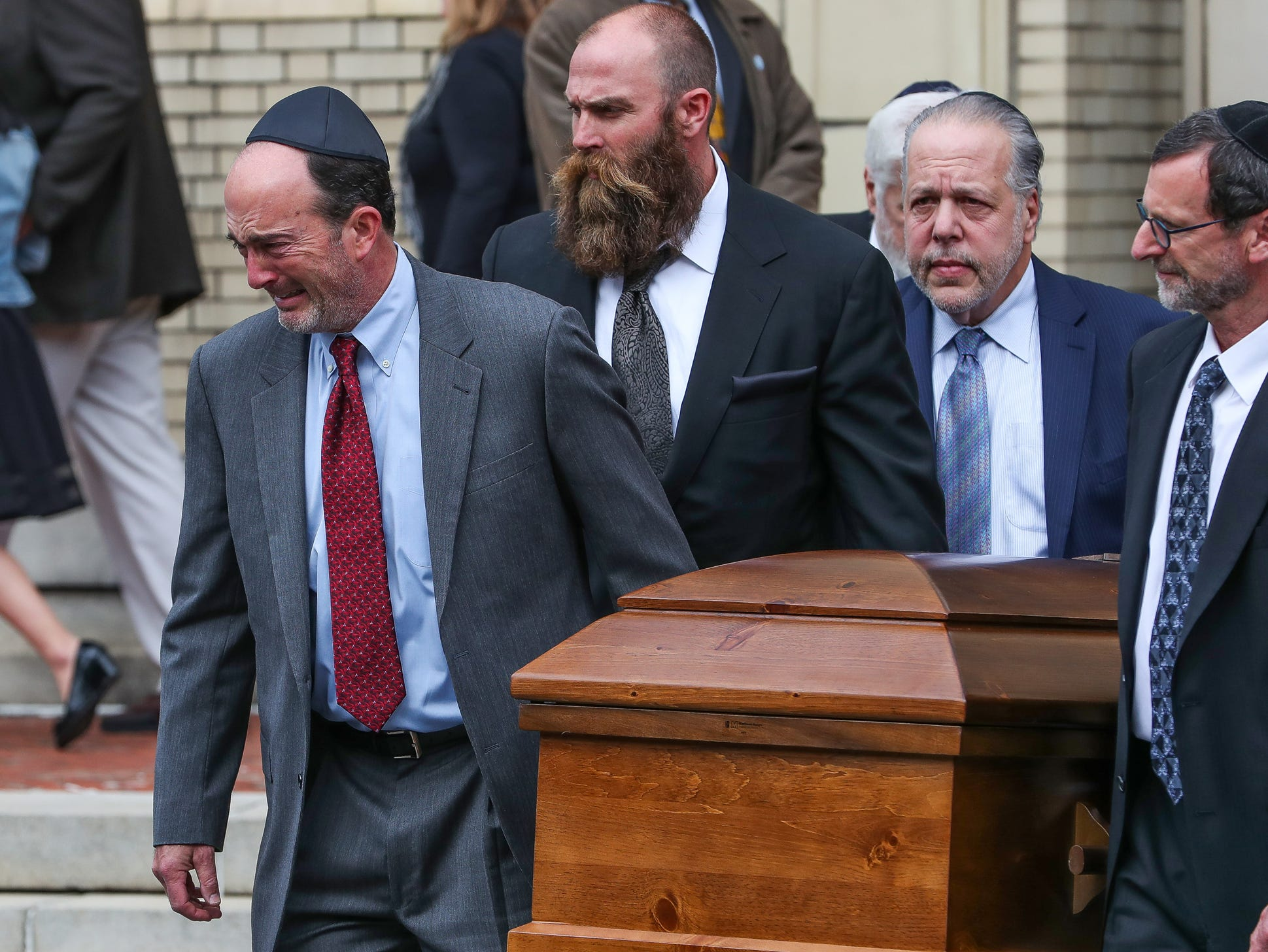 The caskets of brothers David and Cecil Rosenthal are carried out of Rodef Shalom Synagogue in Pittsburgh on Tuesday, Oct. 30, 2018. The two brothers were killed in the Tree of Life Synagogue shooting.