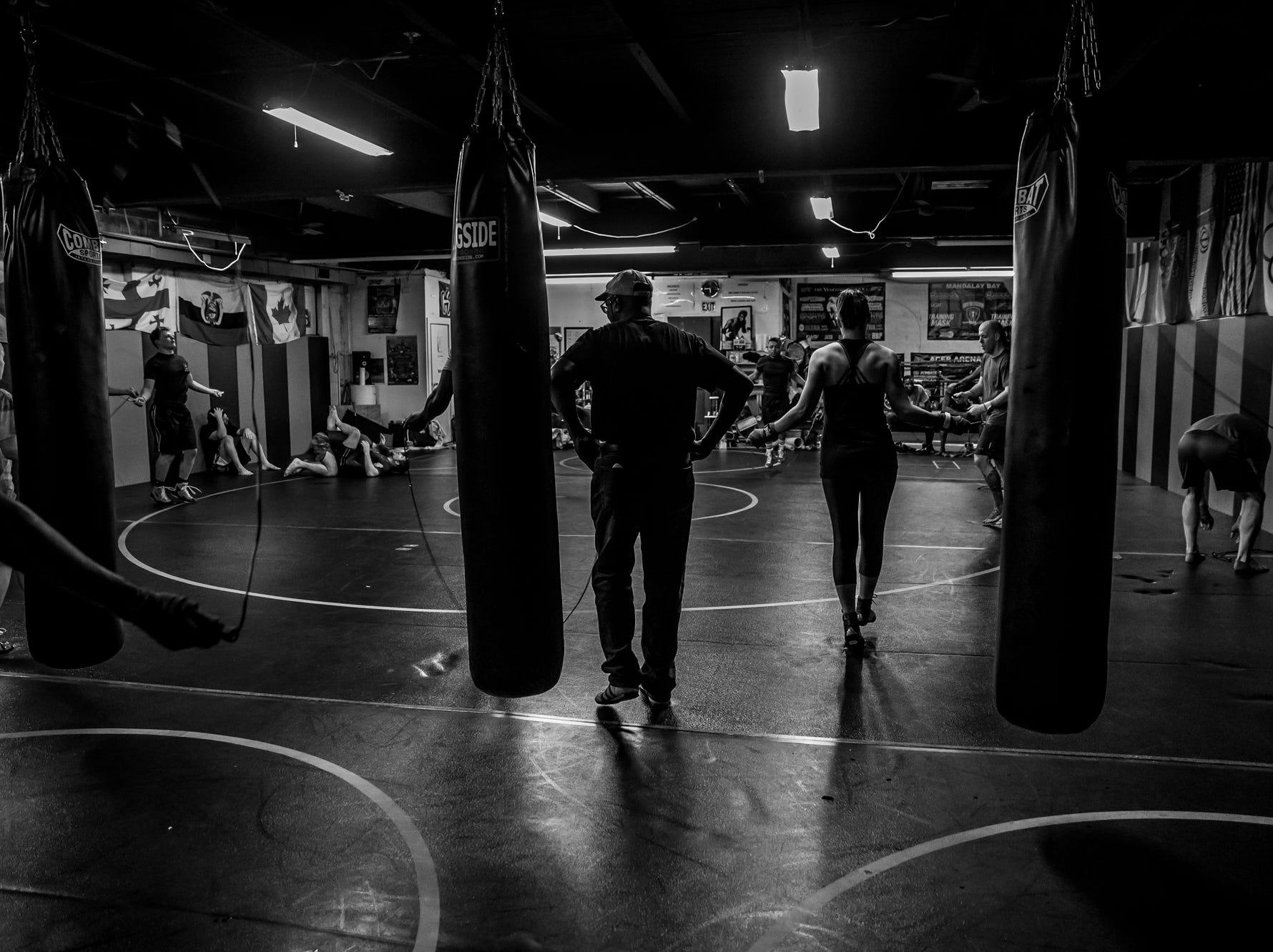 Sugar Ray Seales watches as students at Indy Boxing and Grappling warm up before practice on Monday, March 26, 2018.