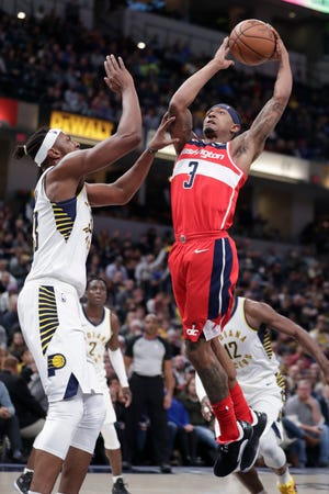 Washington Wizards guard Bradley Beal (3) shoots over Indiana Pacers center Myles Turner (33) during the first half of an NBA basketball game in Indianapolis, Monday, Dec. 10, 2018.