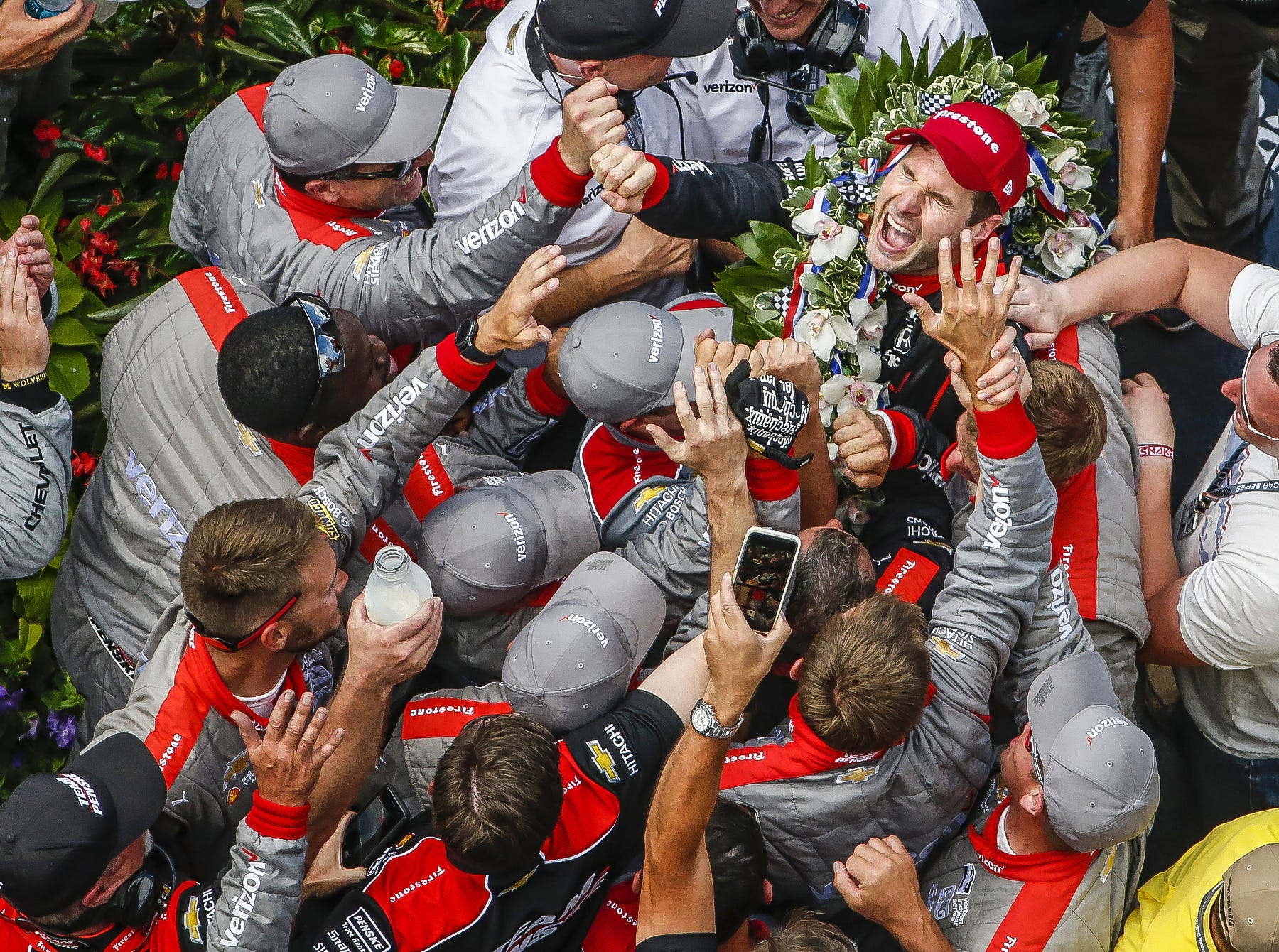 Team Penske IndyCar driver Will Power (12) celebrates in Victory Lane after winning the 102nd running of the Indianapolis 500 at Indianapolis Motor Speedway on Sunday, May 27, 2018.