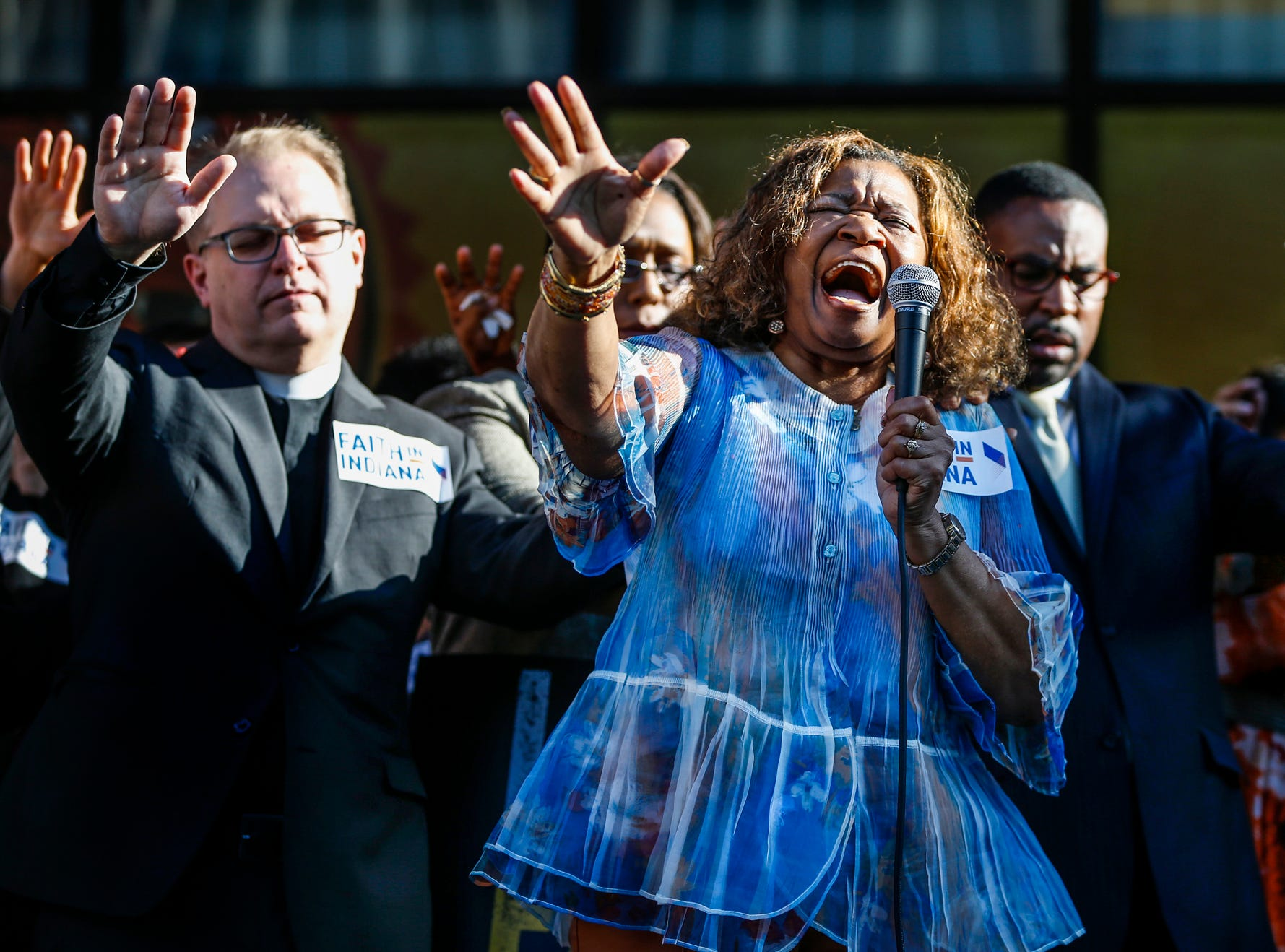 Sharon Trotter, associate pastor at Promise Land Christian Community Church, prays alongside local clergy, community leaders and activists before the final day of the Civilian Police Merit Board hearing in Indianapolis, on Thursday, May 10, 2018. The seven-member board will decide whether to accept the police chief's recommendation to fire the two officers, Michal P. Dinnsen and Carlton J. Howard.  Dinnsen and Howard shot and killed Aaron Bailey on June 29, after Bailey fled a traffic stop. The officers said Bailey ignored their commands to show his hands and instead reached into the car's center console, where they thought he sought a gun. No weapon was found.