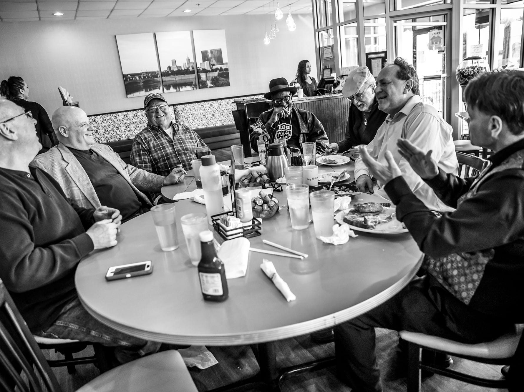 A 30-year tradition, Sugar Ray Seales and a group of his friends grab lunch at Lincoln Square Pancake House on 56th Street in Indianapolis on Thursday, April 5, 2018. From left, Keith Boggs, president of Indiana Golden Gloves, Bill Cowell, Frank Evans, former Indiana commission's director of boxing, Fred Berns, a boxing promoter for 40 years, longtime sports photographer Scott Romer and Craig Houk, a former professional boxer, laugh with Seales, middle, during their lunch. 