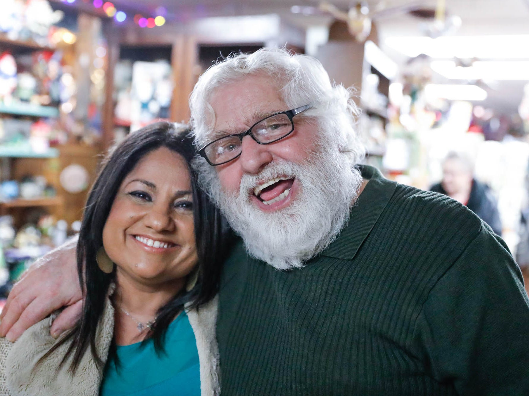 "Heidelberg Haus Cafe and Bakery owner Juergen ""JJ"" Jungbauer hugs staff member Gulschen Martinez, during a party celebrating the cafe's 50th year in business, on Saturday, Dec. 8th, 2018."