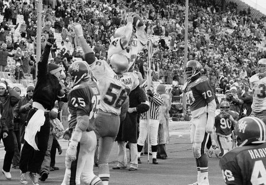 Notre Dame's split end, Kris Haines, holds the ball high overhead after catching A touchdown pass from quarter back Joe Montana in closing seconds of Cotton Bowl Classic in Dallas, Monday, Jan. 2, 1979. This touchdown tied the game and the extra point kicked by Joe Unis won the game for the Irish as they defeated University of Houston 35-34.