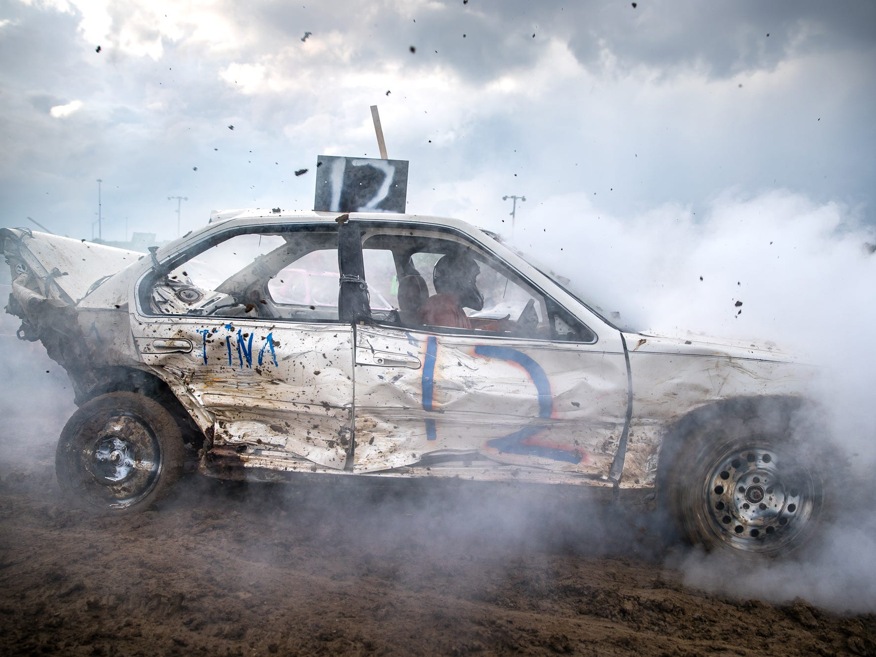 Clatyon Rhoton's car begins to smoke halfway through the demolition derby at the Marion County Fair on Friday, June 22, 2018.