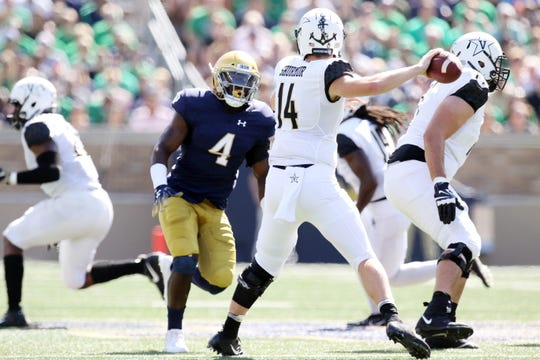 Notre Dame Fighting Irish linebacker Te'von Coney (4) pursues Vanderbilt Commodores quarterback Kyle Shurmur (14) in game between the Notre Dame Fighting Irish and the Vanderbilt Commodores at Notre Dame Stadium in South Bend, Ind., on Saturday, Sept. 15, 2018.
