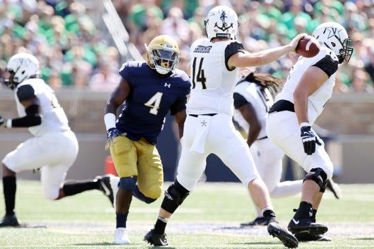 Notre Dame Fighting Irish linebacker Te'von Coney (4) pursues Vanderbilt Commodores quarterback Kyle Shurmur (14) in game between the Notre Dame Fighting Irish and the Vanderbilt Commodores at Notre Dame Stadium in South Bend, Ind., on Saturday, Sept. 15, 2018.