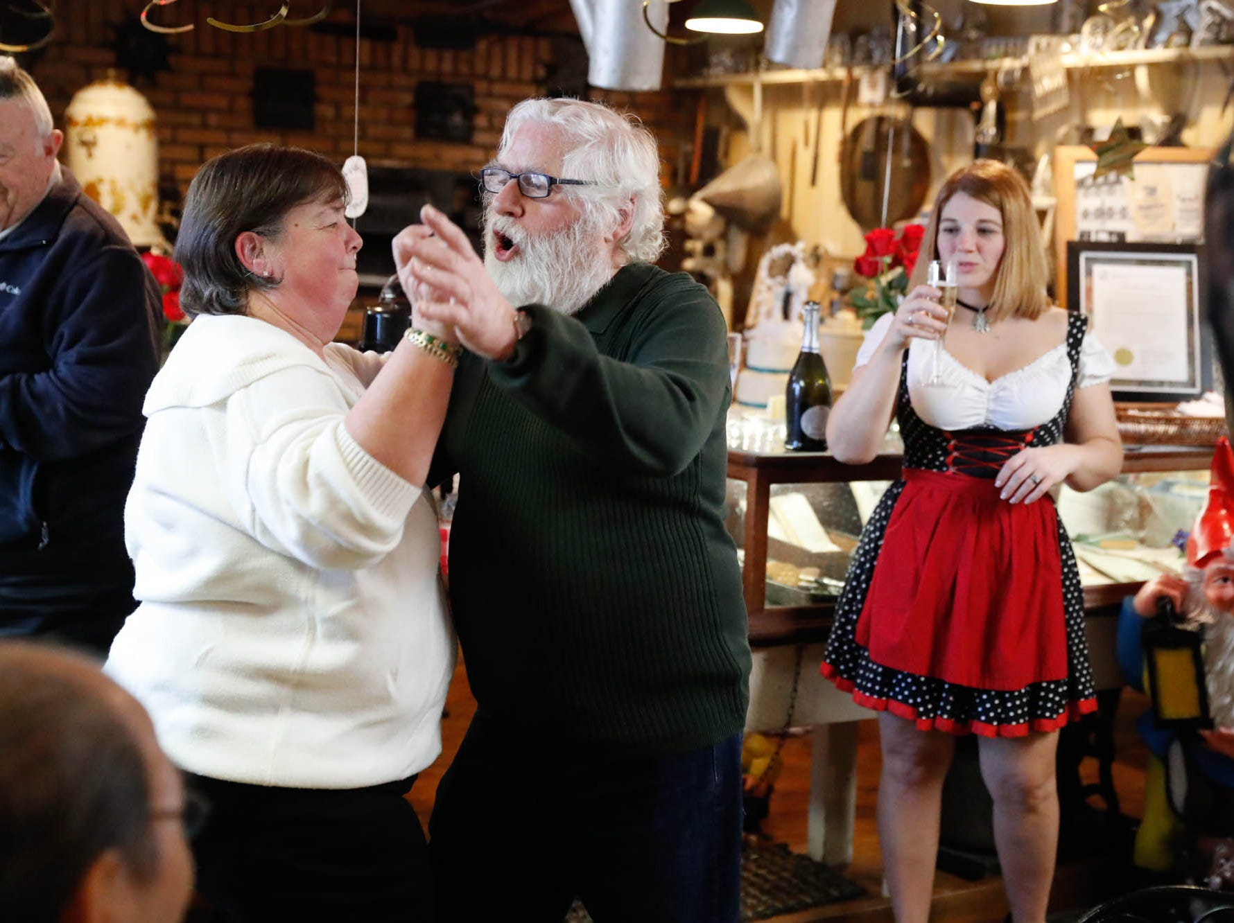 "Heidelberg Haus Cafe and Bakery owners Gabi, left, and  Juergen ""JJ"" Jungbauer celebrate the Cafe's 50th year in business with a party on Saturday, Dec. 8th, 2018. The couples children and regular customers were on hand for the celebration."