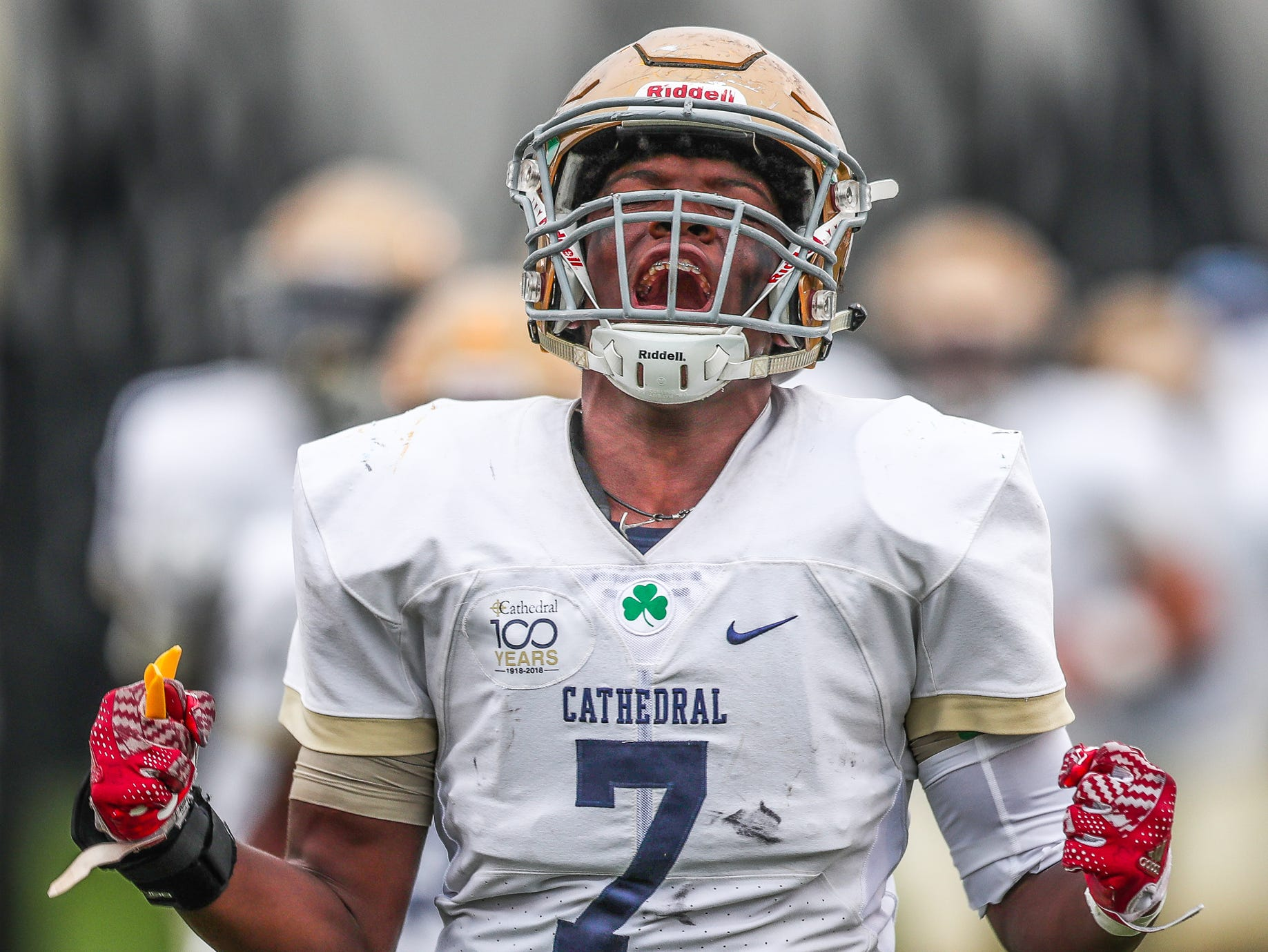 Cathedral's William Chapman (7) takes the field along with the rest of the Fighting Irish to face off against the Brownsburg Bulldogs at Brownsburg High School on Friday, Aug. 24, 2018.