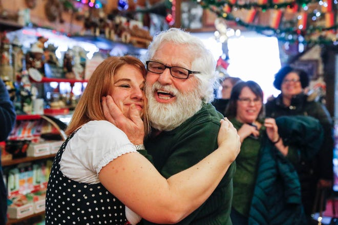 "Heidelberg Haus Cafe and Bakery Cafe Manager, Angela Corkwell, and her father, cafe owner Juergen ""JJ"" Jungbauer, dance during the cafe's 50th year in business party at Heidelberg Haus, 7625 Pendleton Pike, Indianapolis, on Saturday, Dec. 8th, 2018. The cafe, bakery, and German grocery are well known for its extensive collection of German Kitsch and baked goods."