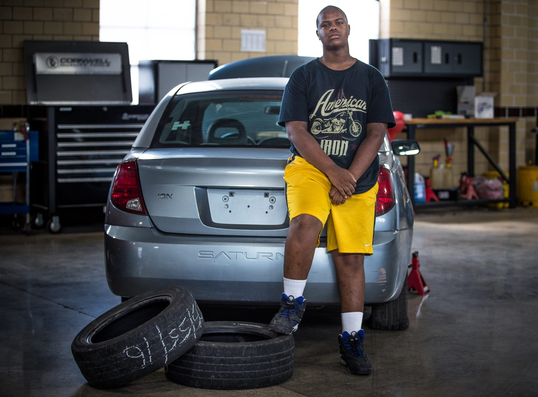 Deanthony Patterson, 16, poses for a portrait inside City Life Wheels, an auto repair shop on Indianapolis' east side, on Tuesday, July 3, 2018. City Life Wheels is a program of Central Indiana Youth for Christ where Marion County teens, ages 14 to 19, can learn basic auto mechanics.