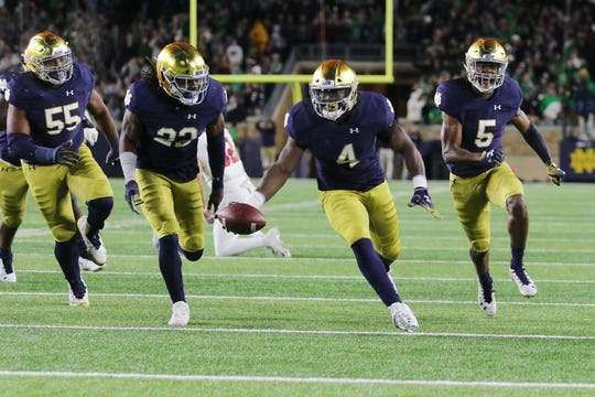 Notre Dame Fighting Irish linebacker Te'von Coney (4) celebrates a interception in game between the Notre Dame Fighting Irish and the Stanford Cardinal at Notre Dame Stadium in South Bend, Ind., on Saturday, Sept. 29, 2018.