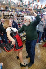 """Heidelberg Haus Cafe and Bakery Cafe Manager, Angela Corkwell, and her father, cafe owner Juergen """"JJ"""" Jungbauer, dance during the cafe's 50th year in business party at Heidelberg Haus, 7625 Pendleton Pike, Indianapolis, on Saturday, Dec. 8th, 2018. The cafe, bakery, and German grocery are well known for its extensive collection of German Kitsch and baked goods."""