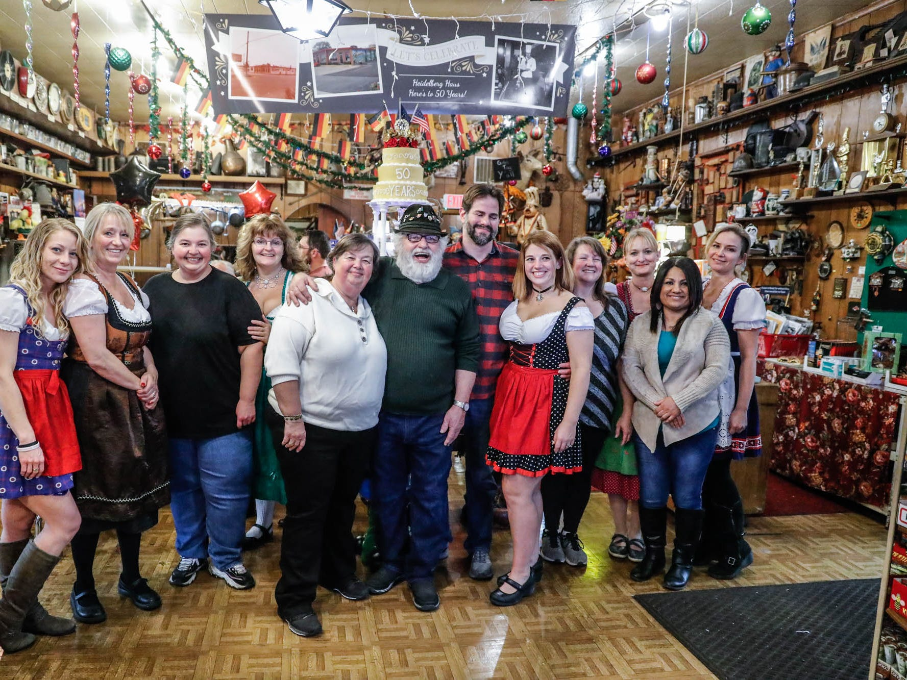 Heidelberg Haus Cafe and Bakery, 7625 Pendleton Pike, Indianapolis Ind., staff pose for photos as they celebrate the cafe's 50th year in business on Saturday, Dec. 8th, 2018. The cafe, bakery, and German grocery is well known for its extensive collection of German Kitsch.