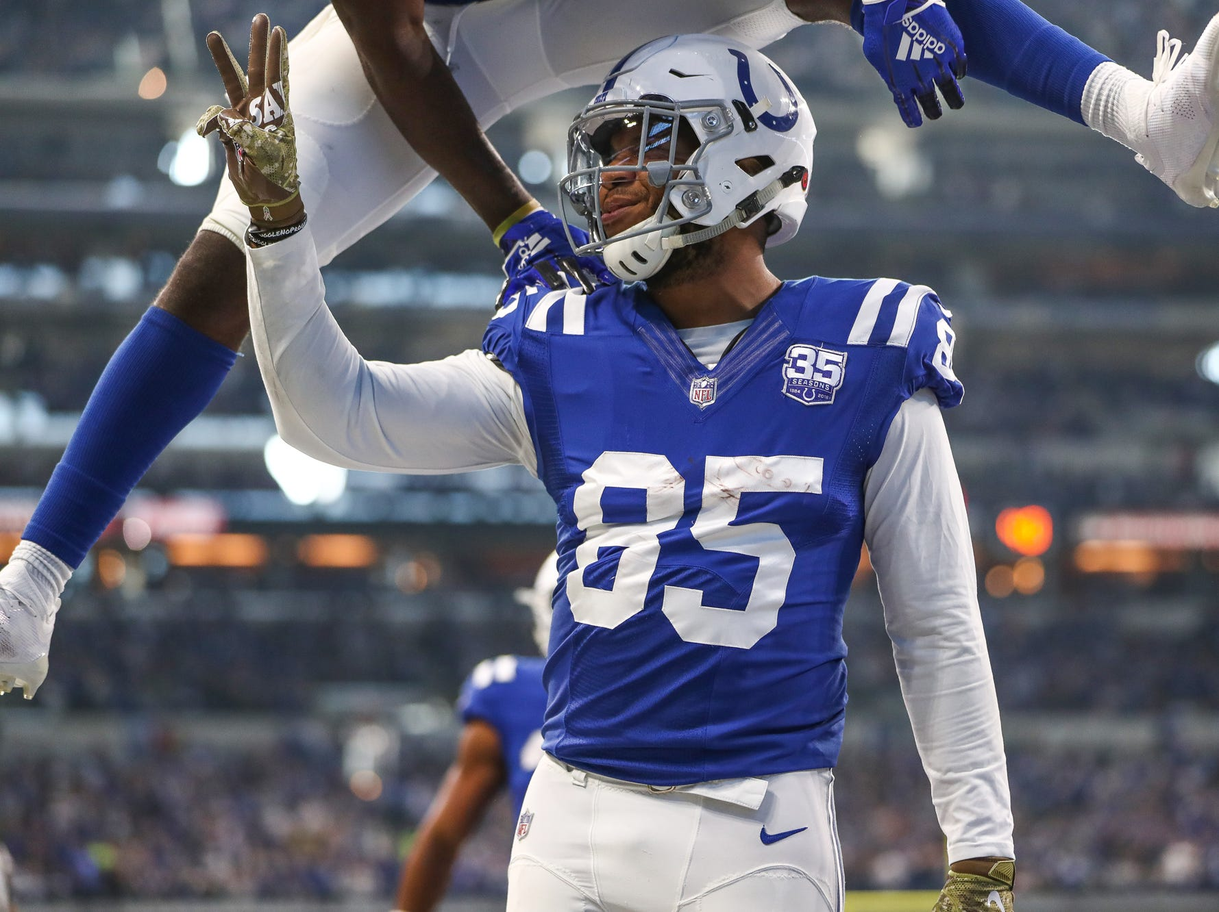 Indianapolis Colts wide receiver Zach Pascal (14) jumps over tight end Eric Ebron (85) as he celebrates his third touchdown of the game against the Jacksonville Jaguars at Lucas Oil Stadium on Sunday, Nov. 11, 2018.