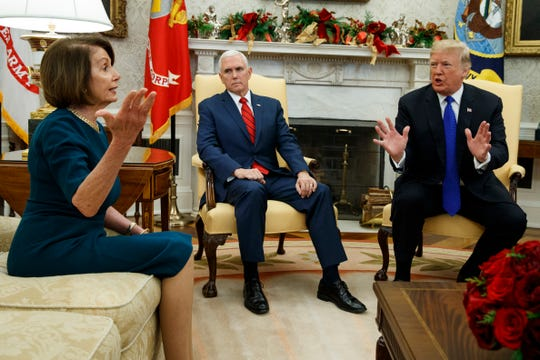 Vice President Mike Pence (center) looks on as House Minority Leader Rep. Nancy Pelosi, D-Calif., and President Donald Trump speak during a meeting in the Oval Office of the White House, Tuesday, Dec. 11, 2018, in Washington. (AP Photo/Evan Vucci)