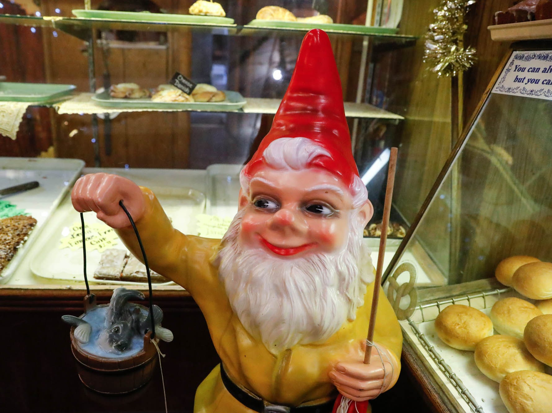 A large gnome welcomes guests to the pastry counter at the Heidelberg Haus Cafe and Bakery, 7625 Pendleton Pike, Indianapolis Ind., on Saturday, Dec. 8th, 2018. The cafe, bakery, and German grocery is well known for its extensive collection of German Kitsch.