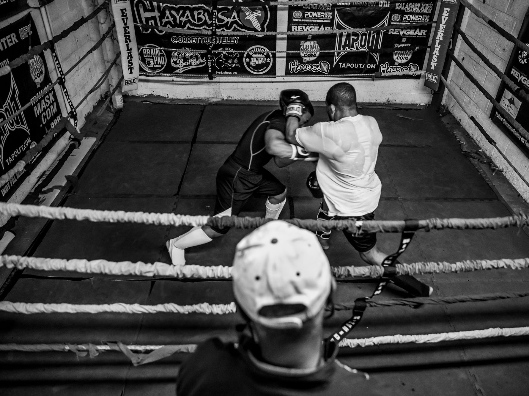 Sugar Ray Seales watches to fighters spar during practice at Indy Boxing and Grappling on Monday, March 26, 2018.