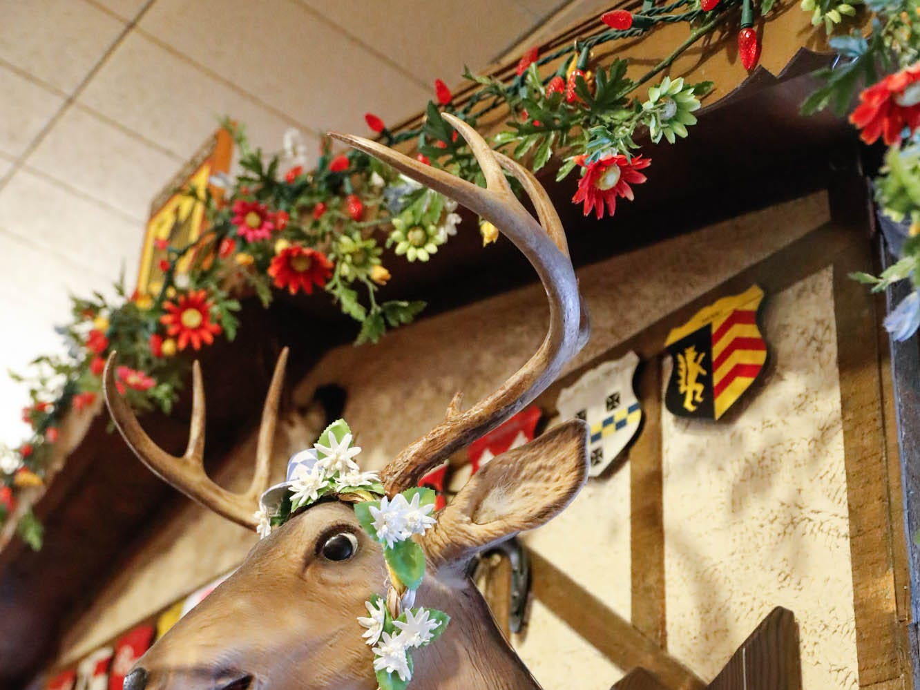 A foe deer head hangs on the wall at Heidelberg Haus Cafe and Bakery, 7625 Pendleton Pike, Indianapolis Ind., on Saturday, Dec. 8th, 2018. The cafe, bakery, and German grocery is well known for its extensive collection of German Kitsch.