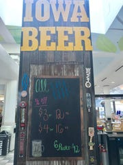 Prices for pours at the Iowa Beer Crafts and Drafts kiosk inside the Coral Ridge Mall are shown on Dec. 11, 2018.