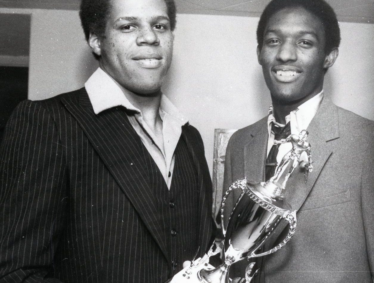 Austin-East grad and All-American linebacker Reggie McKenzie, left,  was honored by the Optimist Club, May, 1981.