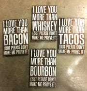 Knock on Wood Knoxville offers clever decorative signs created by owners Ashlee and Adam Moye.
