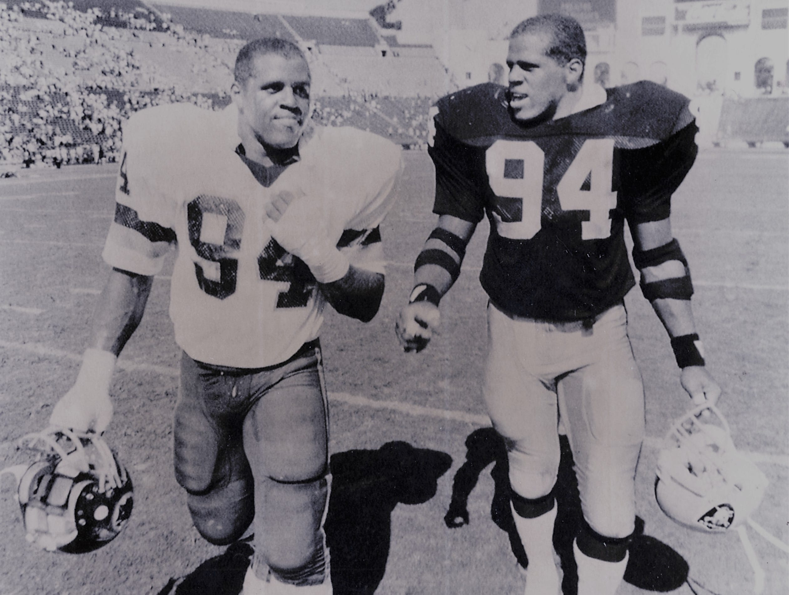 Raleigh and Reggie McKenzie, right, went head to head in the NFL, August 18, 1985. Raleigh played for the Washington Redskins and Reggie played for the (then) Los Angeles Raiders.
