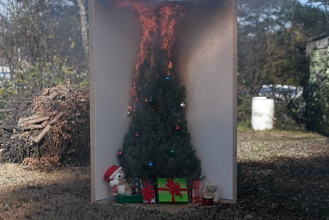 Smoke and flames rise from a Christmas tree during Rural Metro's simulation of a tree catching on fire in a home at station #31 in Powell Tuesday, Dec. 11, 2018.