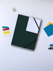 The Origami Day planner includes weekly planning sheets meant to be folded so that only one day at a time can be viewed.