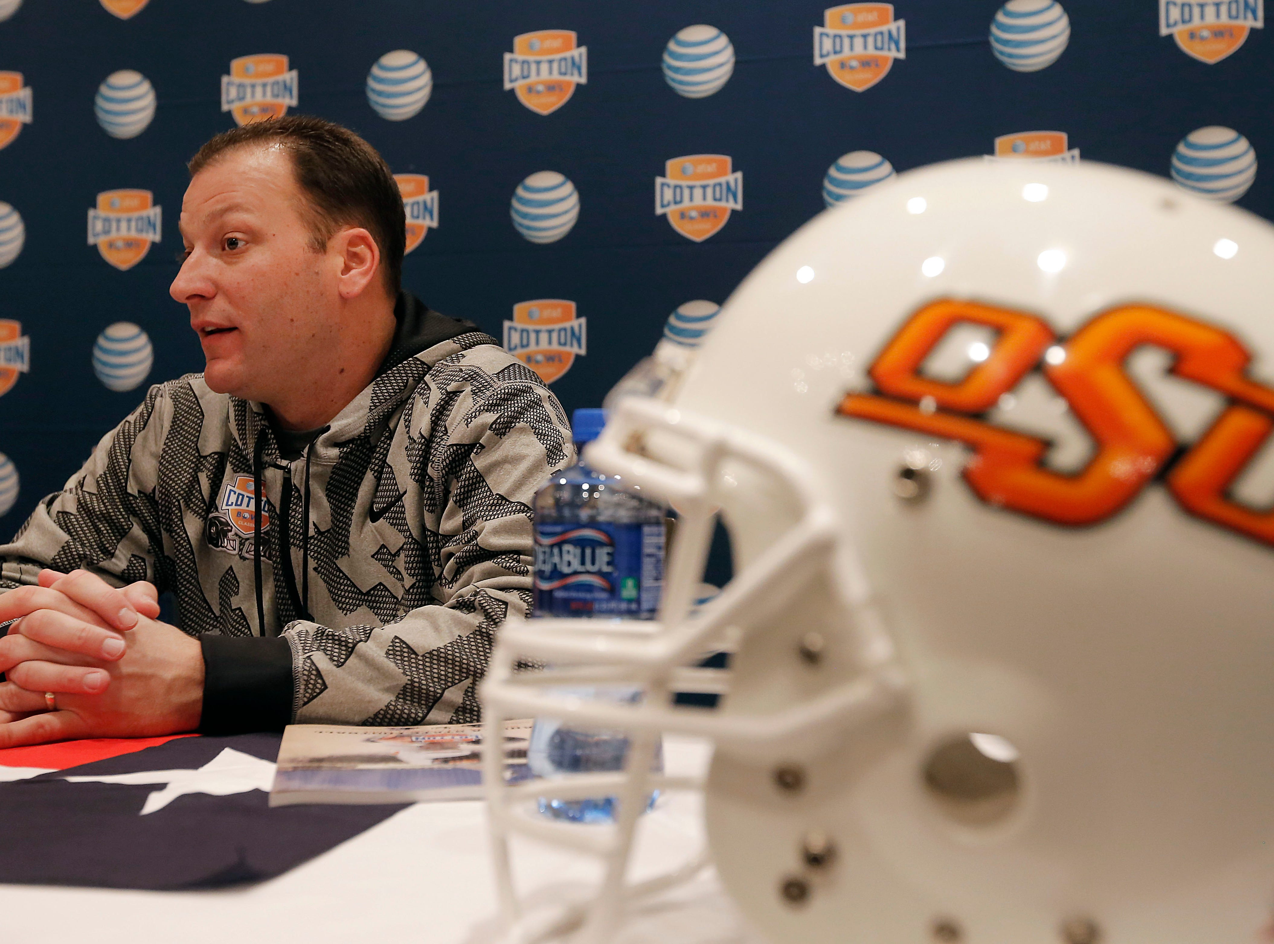 Oklahoma State Offensive Coordinator Mike Yurcich speaks to the media during an NCAA college football press conference, Wednesday, Jan. 1, 2014, in Irving, Texas. Oklahoma State takes on Missouri in the Cotton Bowl on Friday in Arlington, Texas.