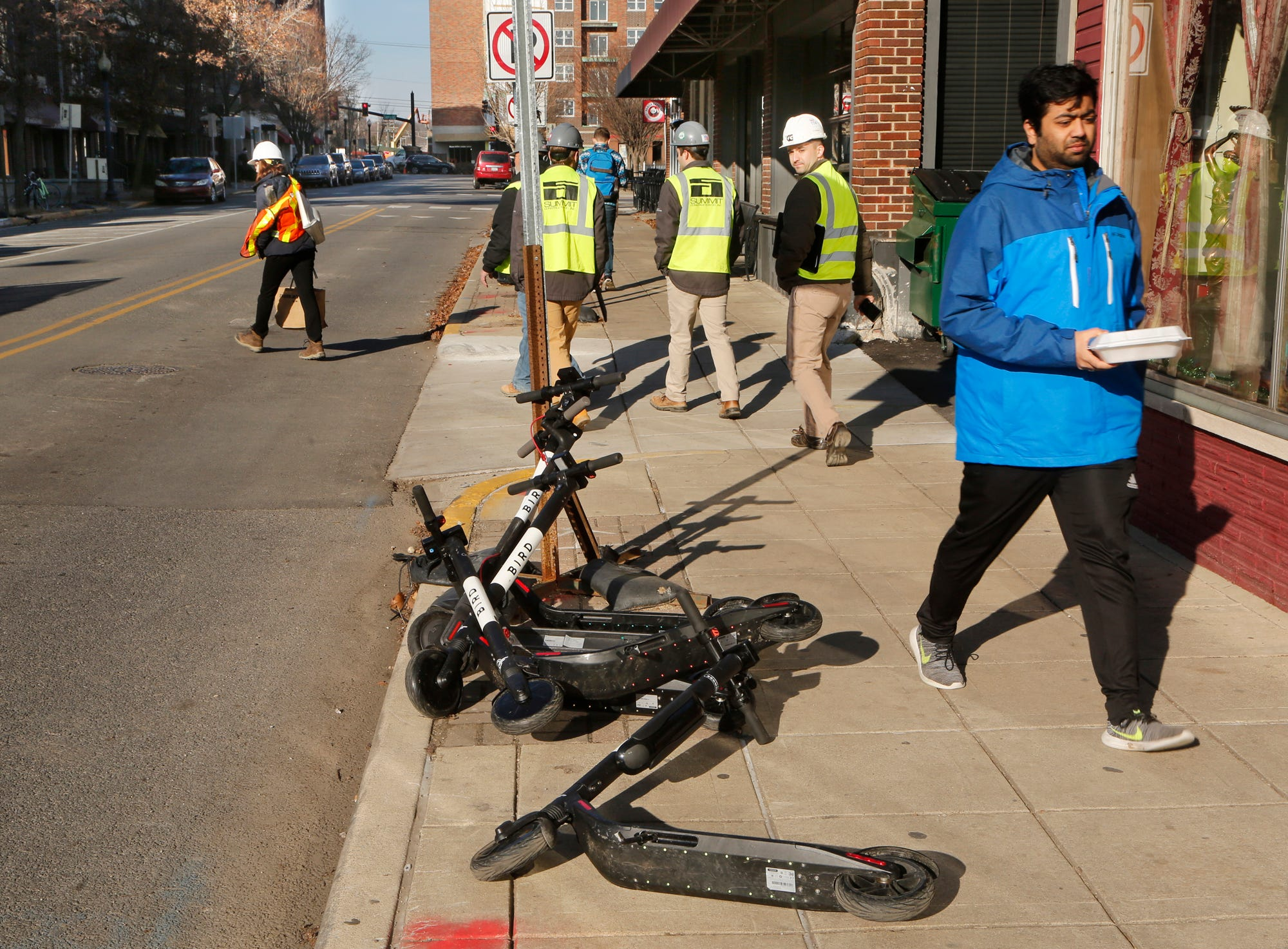 BIRD electric scooters are piled up on the sidewalk in front of Khana Khazana Grill Tuesday, December 11, 2018, at 108 Northwestern Avenue in West Lafayette. West Lafayette started towing the scooters Monday after complaints that they were clogging sidewalks.