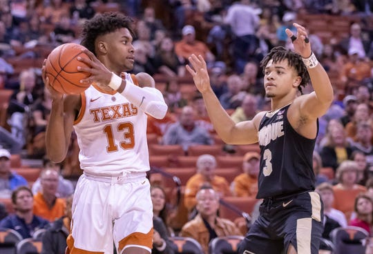 Dec 9, 2018; Austin, TX, USA; Texas Longhorns guard Jase Febres (13) looks to pass the ball as Purdue Boilermakers guard Carsen Edwards (3) defends during the first half at Frank Erwin Center. Mandatory Credit: John Gutierrez-USA TODAY Sports