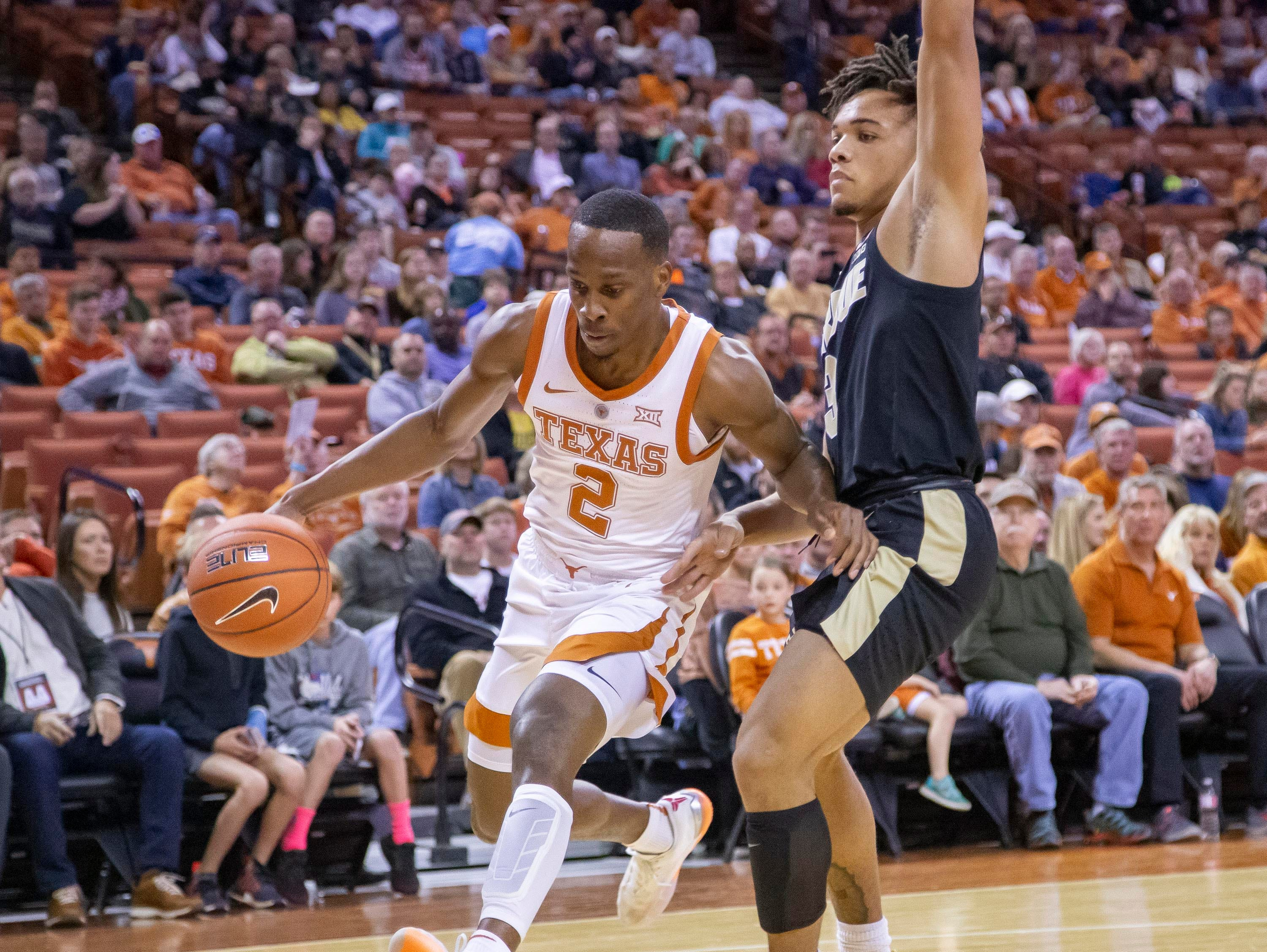 Dec 9, 2018; Austin, TX, USA; Texas Longhorns dribbles the ball to the basket as Purdue Boilermakers guard Carsen Edwards (3) defends during the first half at Frank Erwin Center. Mandatory Credit: John Gutierrez-USA TODAY Sports
