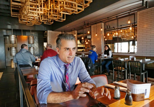 Co-owner John Christos talks about The Bryant, the newest restaurant offering by the Christos family, Tuesday, December 11, 2018, at 1820 Sagamore Parkway West in West Lafayette. The Bryant features a wide variety of food and drink options in an upscale, contemporary setting.