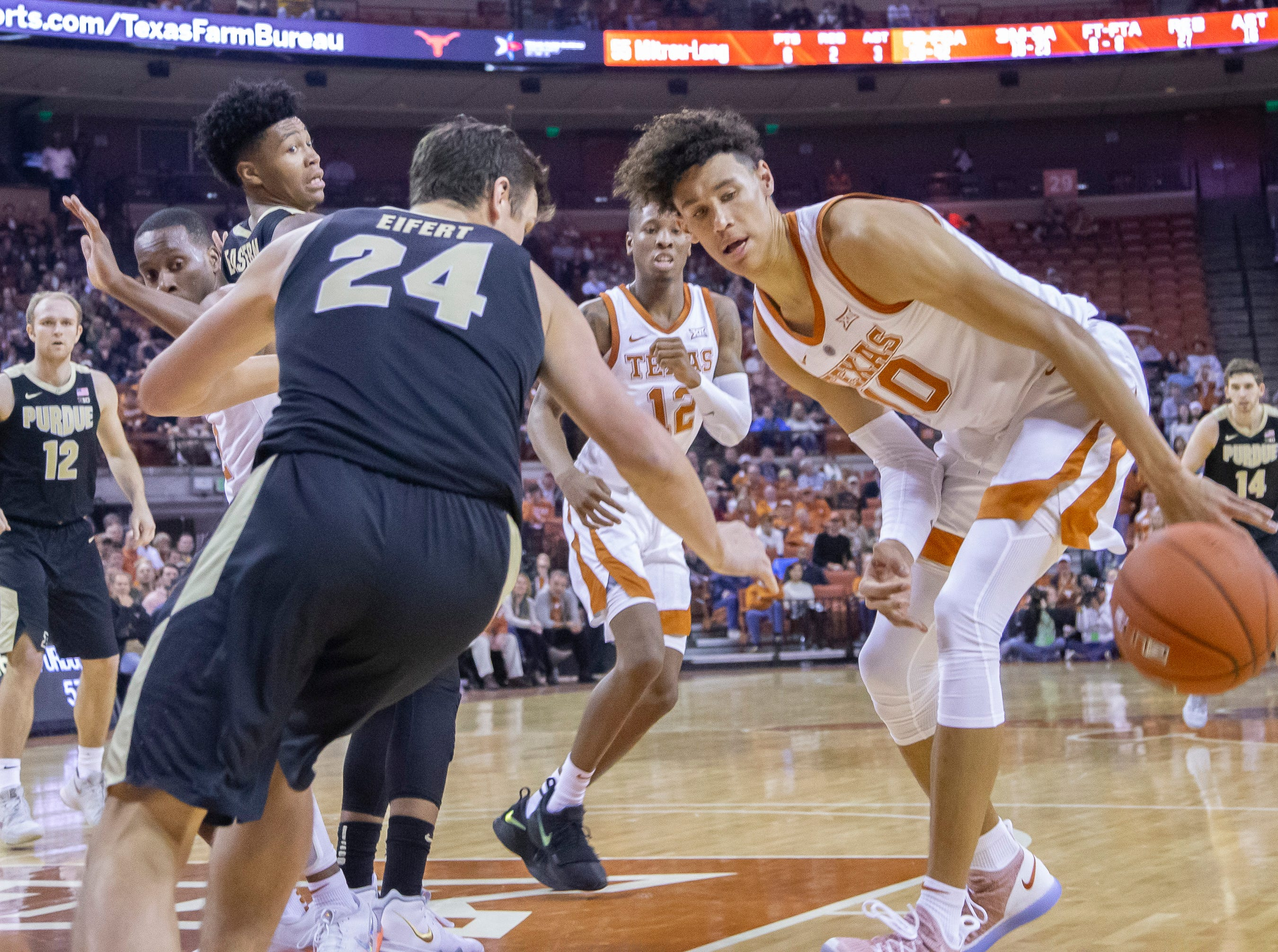 Dec 9, 2018; Austin, TX, USA; Texas Longhorns forward Jaxson Hayes (10) deflects the ball away from Purdue Boilermakers forward Grady Eifert (24) d2h\ at Frank Erwin Center. Mandatory Credit: John Gutierrez-USA TODAY Sports