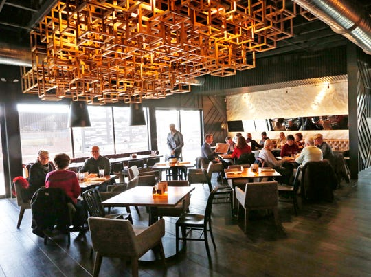 Guests begin to fill the tables during the non hour at The Bryant, the newest restaurant offering by the Christos family, Tuesday, December 11, 2018, at 1820 Sagamore Parkway West in West Lafayette. The Bryant features a wide variety of food and drink options in an upscale, contemporary setting.