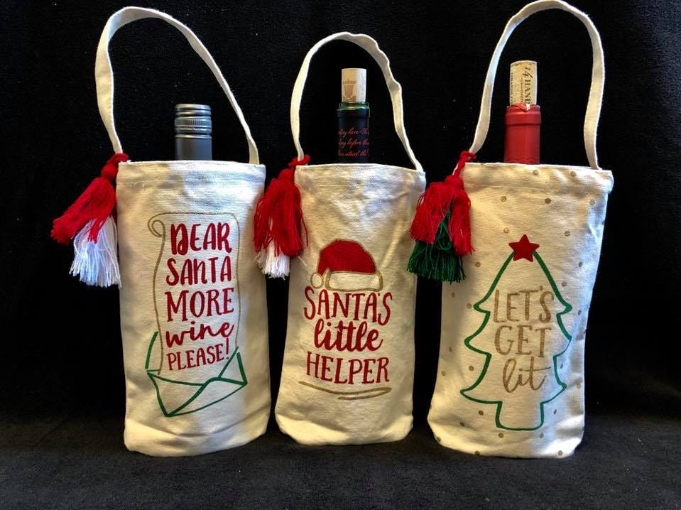 Fun and festive wine bottle bags are a great Christmas party gift . Sold at The Gift Pod