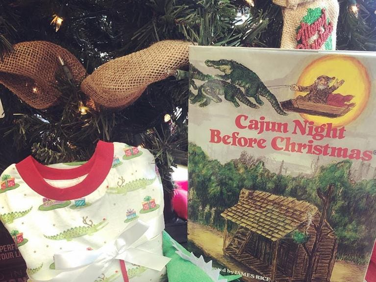 Louisiana-themed children's wear, toys, and local children's books sold at Louisiana Hot Stuff