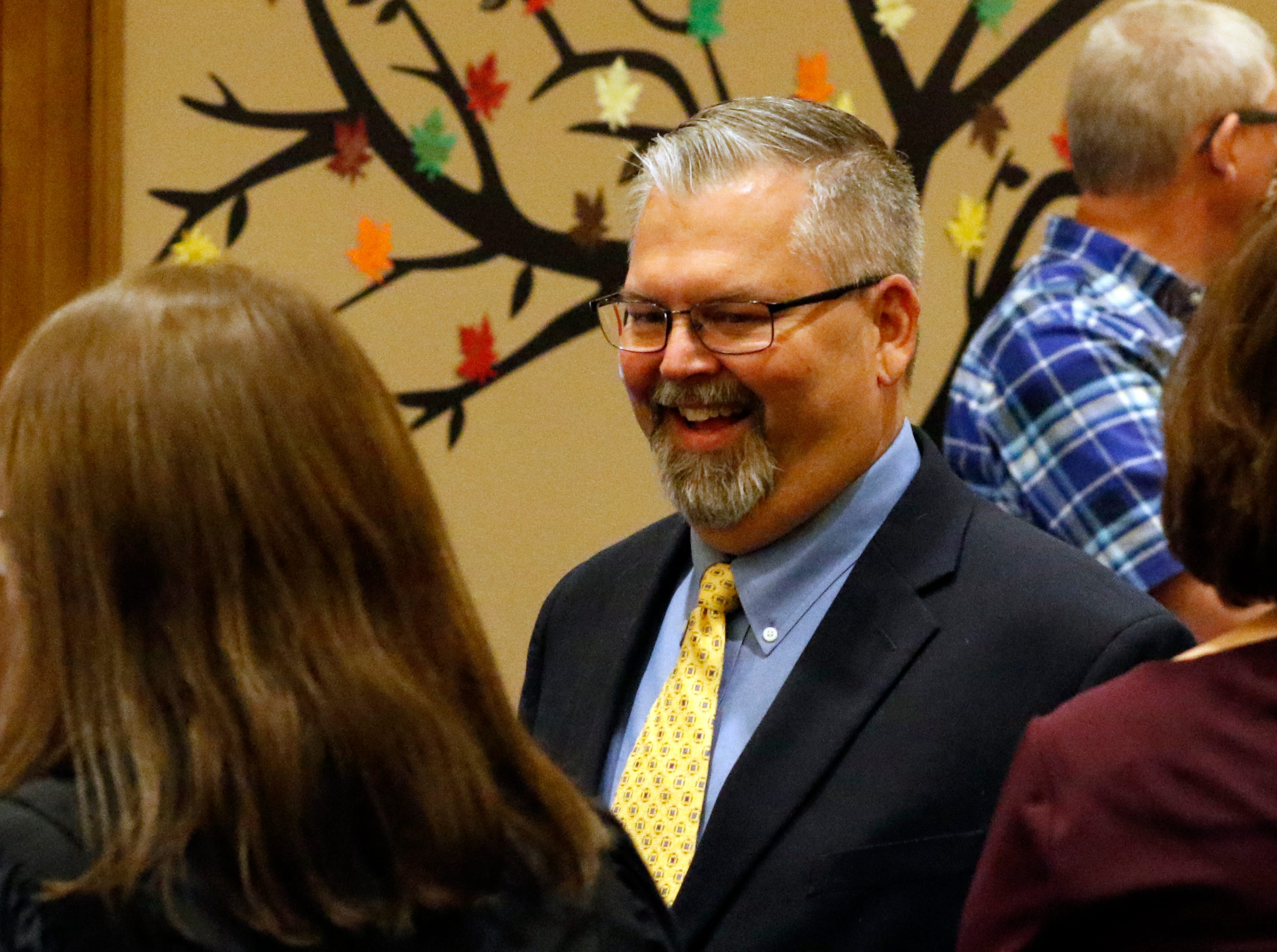 Fairfield County Commissioner-elect Jeff Fix talks with people in the commissioner's hearing room after being sworn in Tuesday morning, Dec. 11, 2018, in Lancaster. Fix will take office in January.