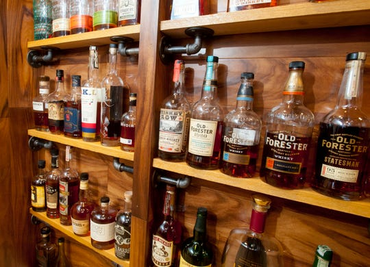 The home's bourbon bar features plenty of the Kentucky spirit.