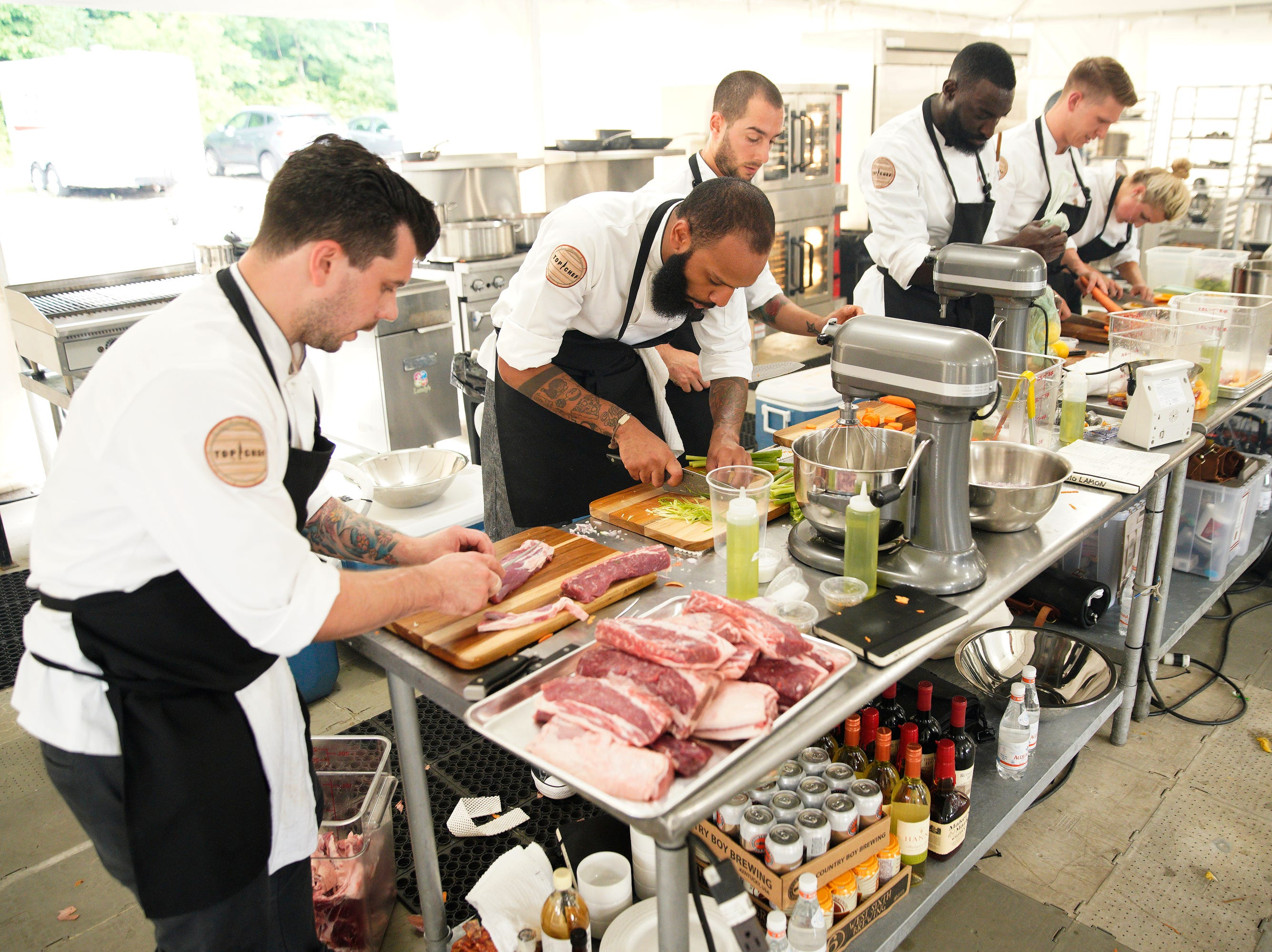 """Top Chef"" contestants prepare for a challenge on episode 2 of season 16."