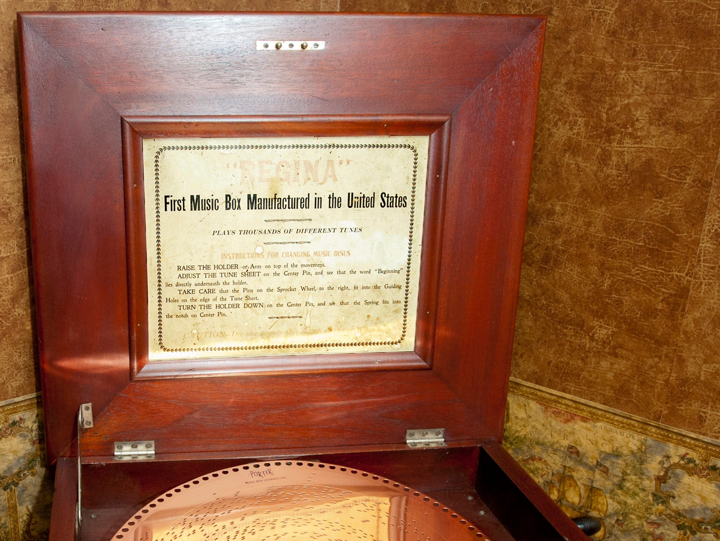 "This Regina music box, built in 1901, was one of the first music boxes manufactured in the United States. It was playing ""Carol of the Bells.""