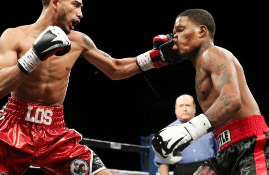 Louisville's Carlos Dixon, left, lands a punch against Aaron Hollis during their match in the Jose Sulaiman World Invitational Tournament at the Yum Center in Louisville.  Dixon won a split decision in the bout.Apr. 27, 2018