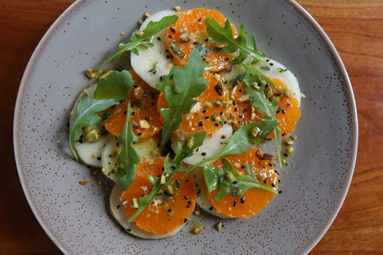 The Pear and Clementine Salad with Tarragon & Nigella Seeds with a Pistachio Oil Vinaigrette served at 610 Magnolia.  Dec. 6, 2018