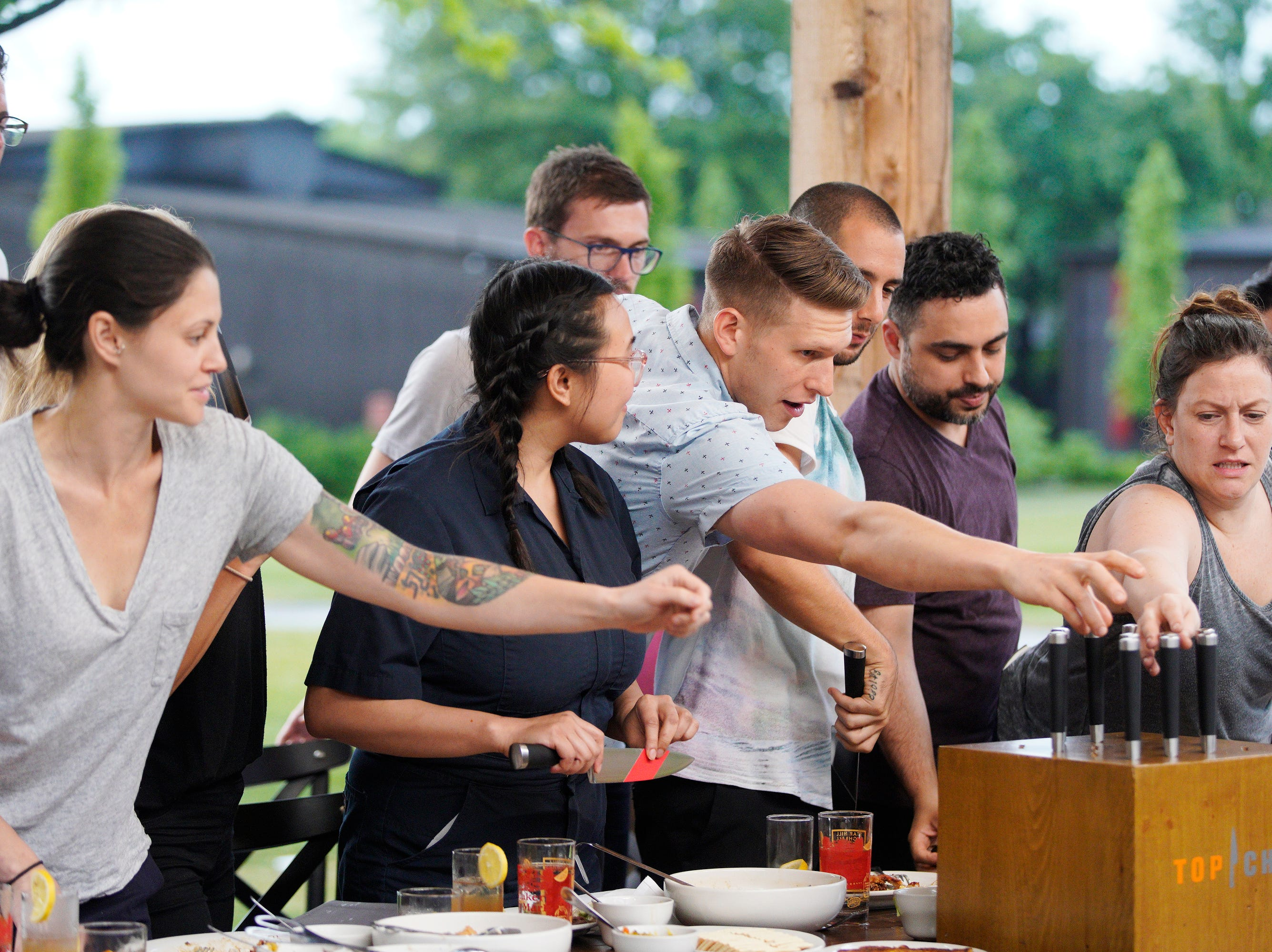 """""""Top Chef"""" contestants draw knives for a challenge on episode 2 of season 16."""