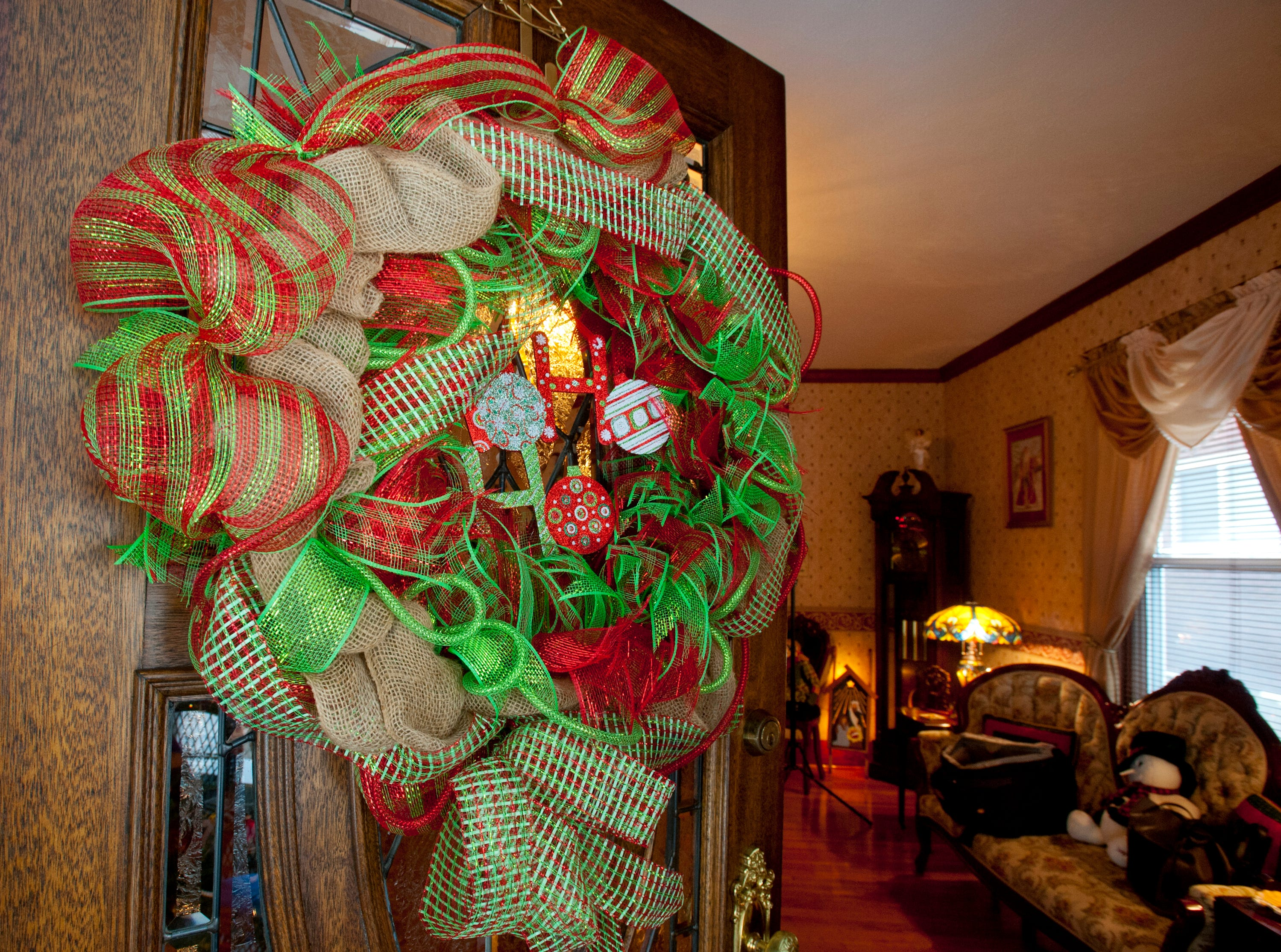 A large Christmas wreath welcomes visitors through the front door of Chis and Kerrie Clifford's Portland home.