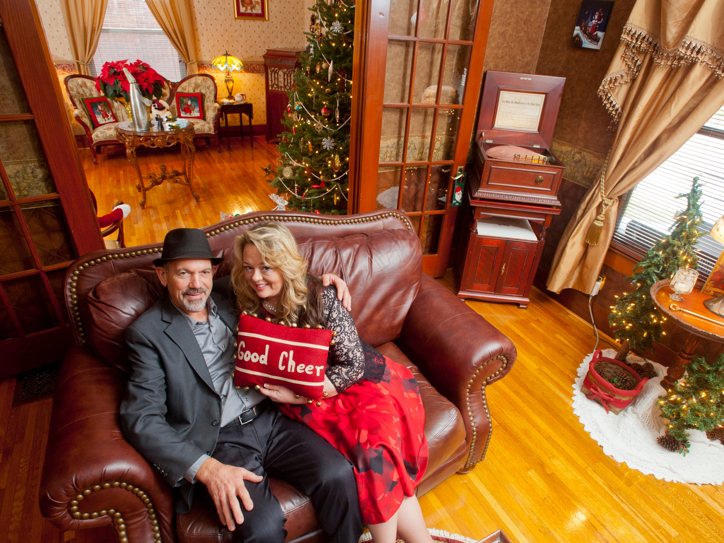 "Chis and Kerrie Clifford relax in their ""Santa Room,"" what they call their den during the Christmas season. 