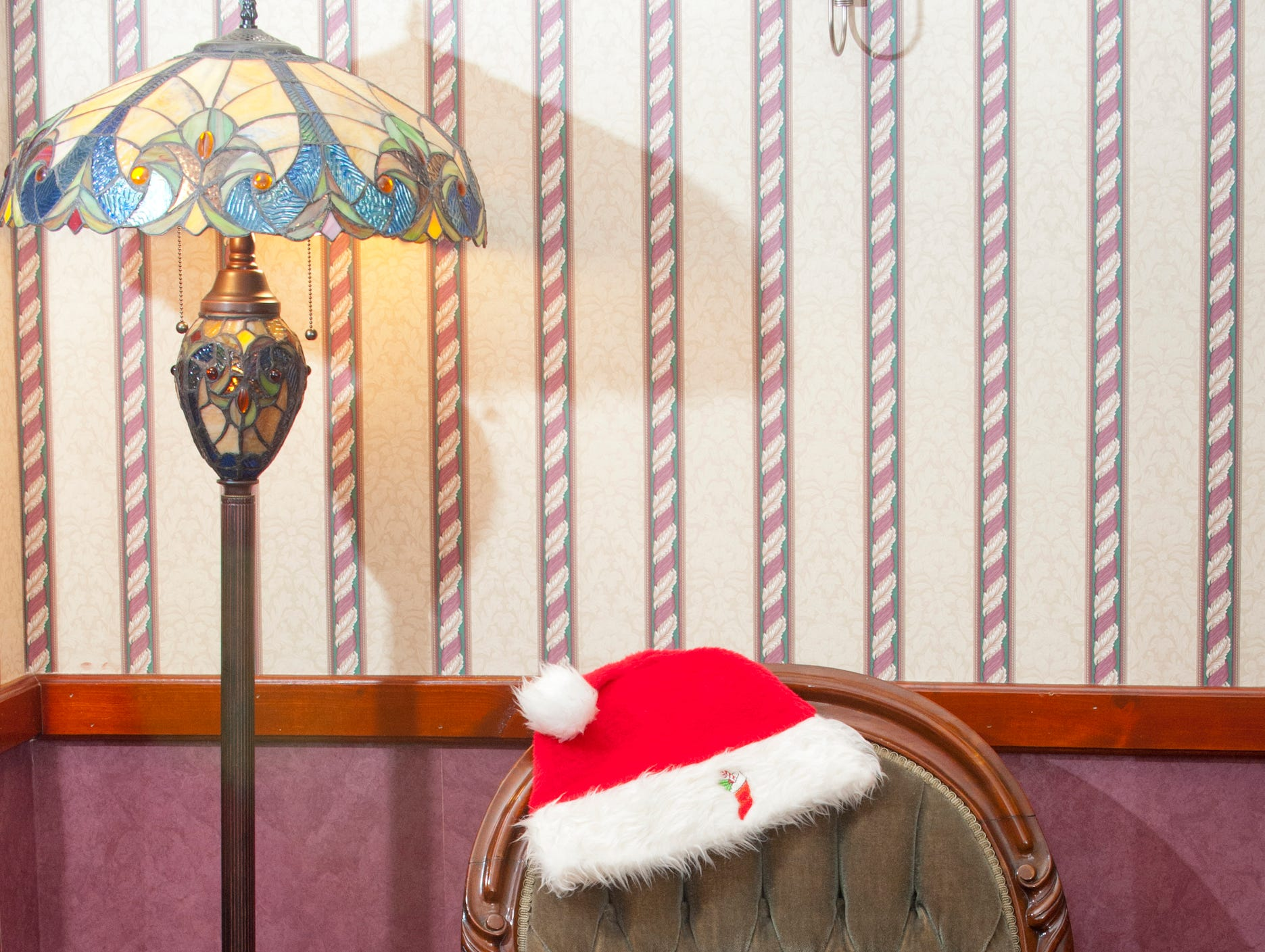 A Santa hat sits atop a chair in the Clifford dining room.