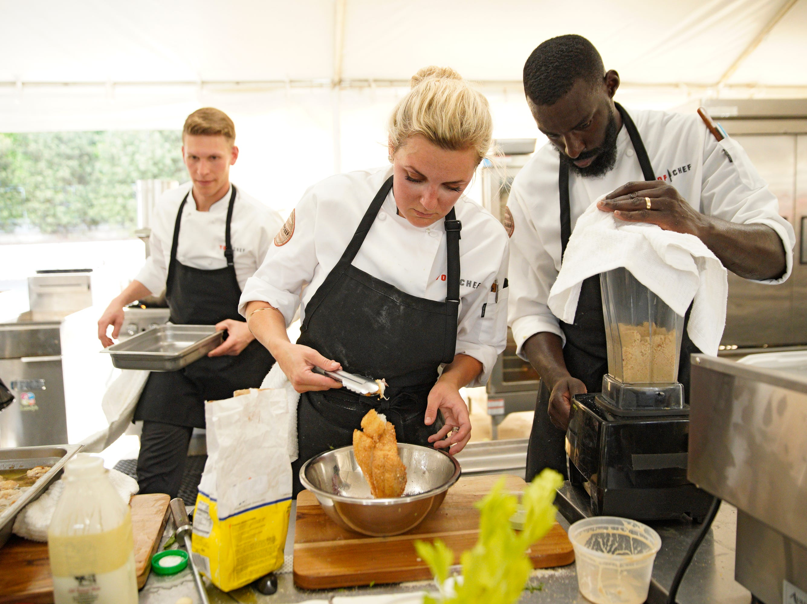 """(Left to right) Chefs Brandon Rosen, Kelsey Barnard and Eric Adjepong compete on episode 2 of """"Top Chef"""" season 16."""