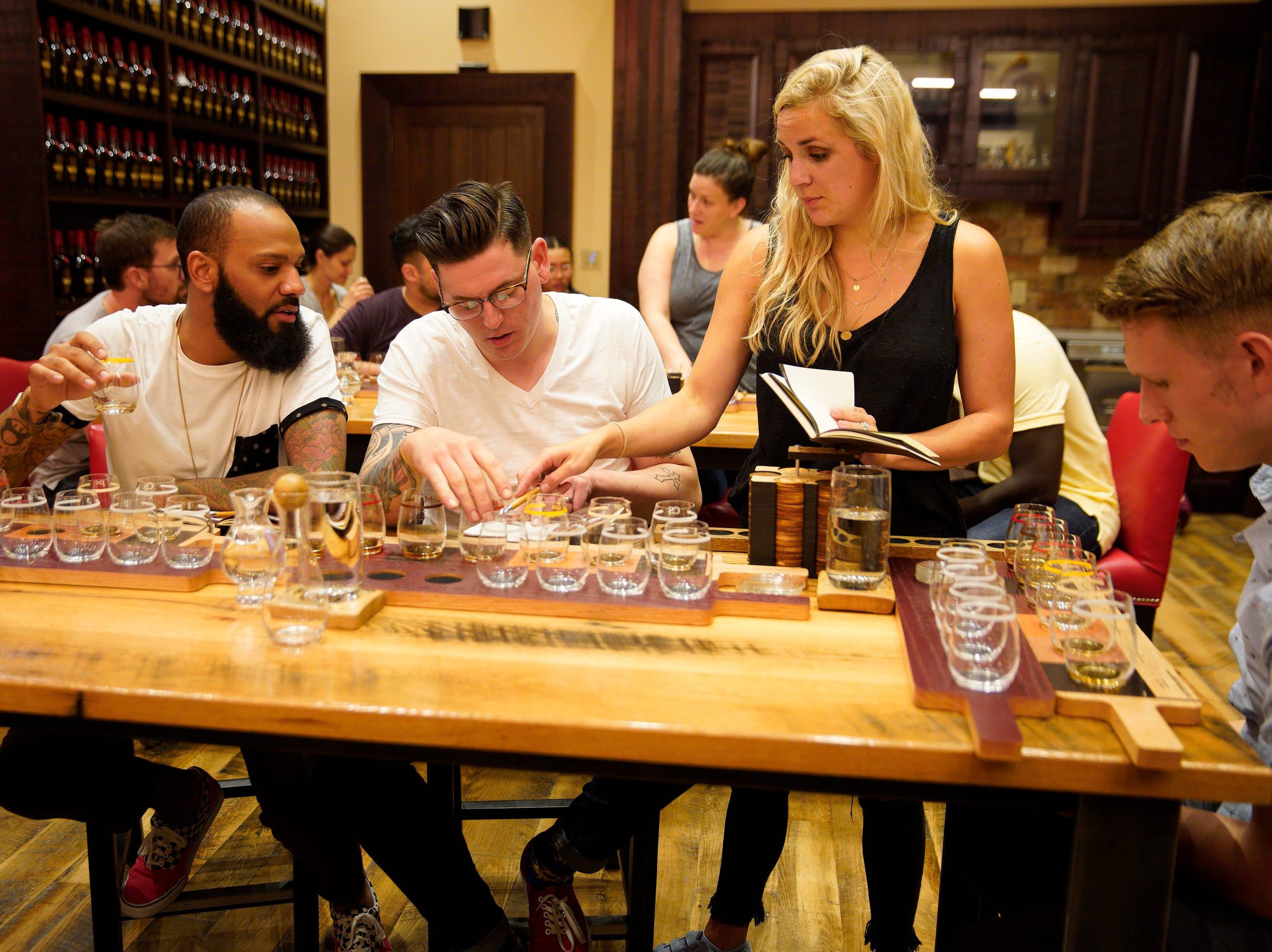 """(Left to right) Chefs Justin Sutherland, Brian Young, Kelsey Barnard and Brandon Rosen taste bourbon at the Maker's Mark distillery on episode 2 of """"Top Chef"""" season 16."""